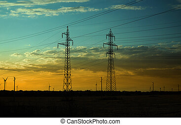 Electricity Pillars and Wind Turbines on sunset