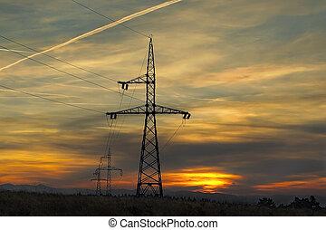 electricity pillars at sunset