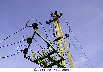 Electricity poles and wires on blue sky background