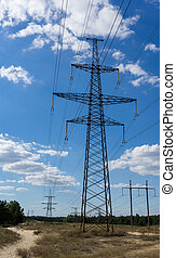 Electricity pylon against the blue sky background