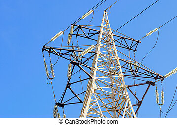 Electricity pylon against blue sky: high voltage electric cables seen from below . Room for text