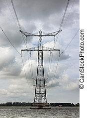 Electricity pylon in Dutch Ketelmeer between Flevoland and Noordoostpolder