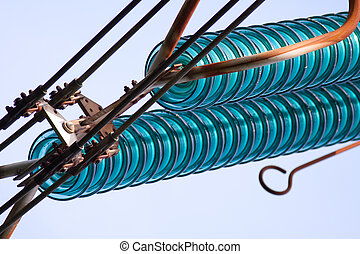 Close up view of glass insulator used on electricity pylon