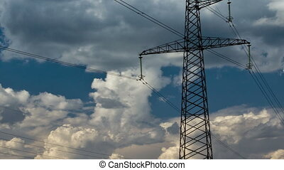 Electricity pylon on blue sky background. (Zooming time...