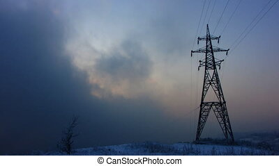 Electricity pylon. - Time lapse of running clouds with...
