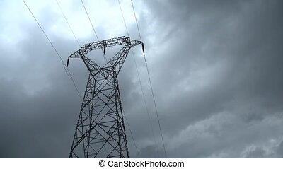 Electricity pylon timelapse - Electricity pylon with stormy...