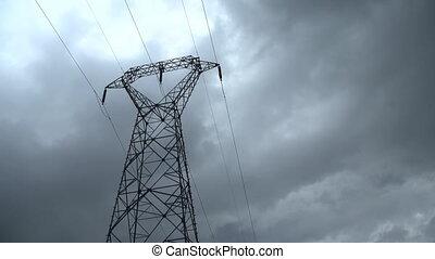 Electricity pylon timelapse - Electricity pylon with stormy...