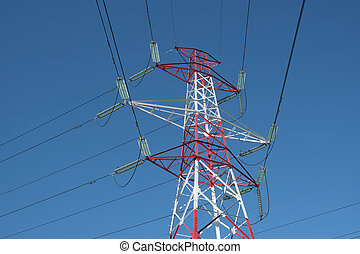High voltage electricity pylon and power lines with clear blue sky