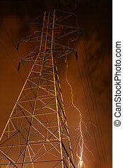 Electricity Pylon with Lightning in Background.