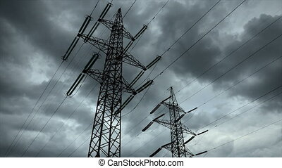 Electricity pylon with stormy sky on the background....