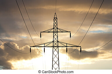 electricity pylons against a nice yellow orange sunset