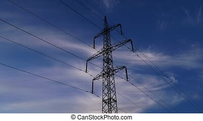 Electricity pylons and clouds sky
