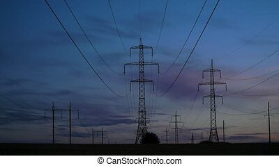 Electricity pylons and the evening sky