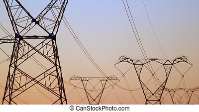 Electricity pylons during sunset 4k - Electricity pylons ...