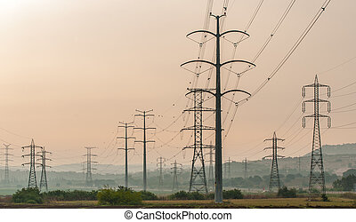 Electricity pylons - High electricity pylons over an...