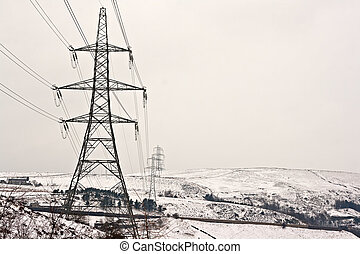 Electricity pylons on snow covered moors - Electricity ...