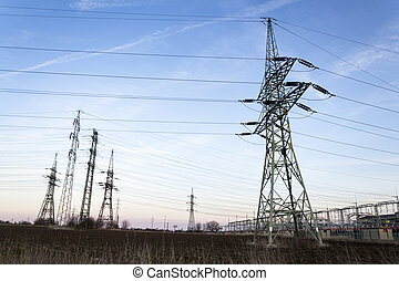Electricity pylons with distribution power station blue cloudy sky