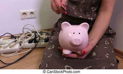 Electricity saving concept with piggy bank