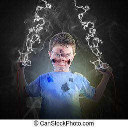 Electricity Science Boy with Plugs - A young boy is holding...