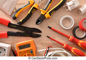 Electricity tools on wooden table close up top