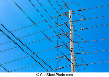 Electricity towers against a blue sky.