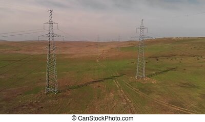 Electricity transmission power lines - High-voltage tower...