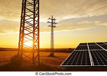 Electricity transmission pylon with solar panel.