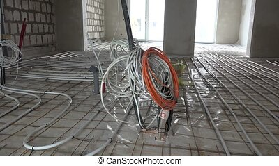Electricity wire installation and floor heating system tubes...
