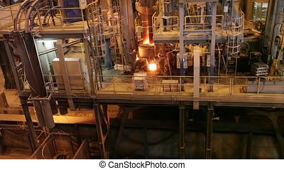 Electroarc furnace at the metallurgical plant - Melting...