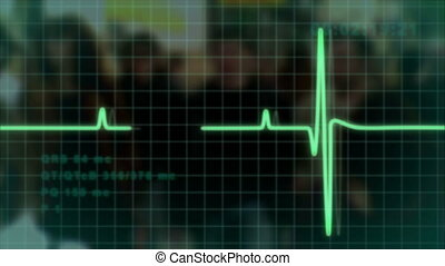 electrocardiogram pulse trace with blurry people at...