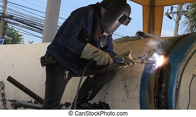 Electrodes for welding and sparks. Welder at work, welding...