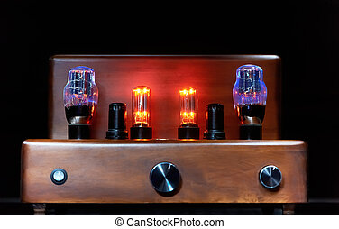electronic amplifier with glowing bulb lamp - Old-fashioned...