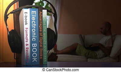 Electronic book and headphones