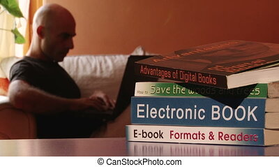 Electronic book, writer working on a laptop
