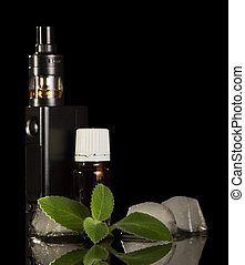 Electronic cigarette, bottle with aromatic liquid, ice cubes and mint, isolated on black