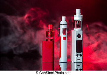Electronic cigarettes on the black background - Electronic...