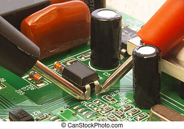 Electronic circuit board close up with different lighting.