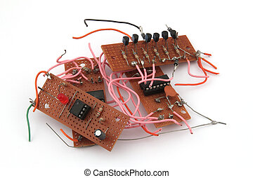 Electronic circuit board on a white background.