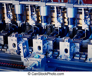 electronic component production - close up of a machine ...