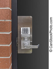 electronic keypad door lock at the rear entrance to a...