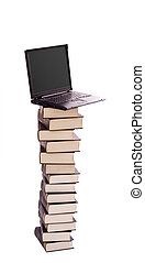 Stacked books and laptop - electronic library, learning and knowledge concept - isolated