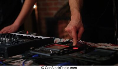 Electronic musicians work in nightclub.