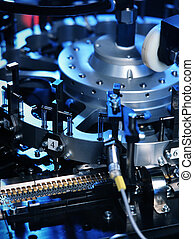electronic part production - detail of machine producing...