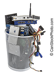 electronic scrap in trash can. keyboard, power supply,...