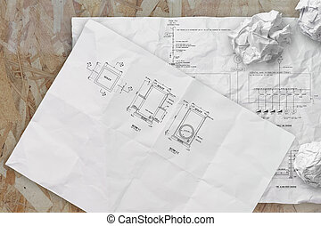 electronic single line and fire alarm riser schematic diagram on crunpled paper
