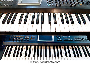 synthesizer - electronic synthesizer with keyboard and knobs...