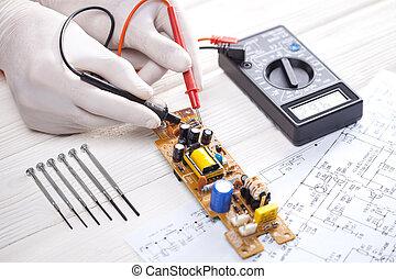 Electronic technician measure electricity