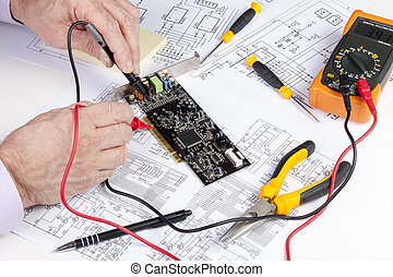Electronics engineer testing