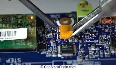 electronics repair. soldering microchips and circuit boards