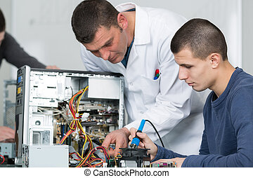 Electronics student working on computer